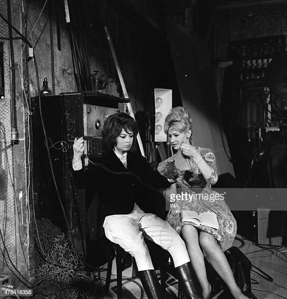 Brigitte Bardot sat next to another woman behind the scenes studios of Joinville