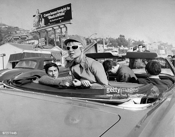 Brigitte Bardot tours Hollywood along Sunset Strip in the back of a convertible