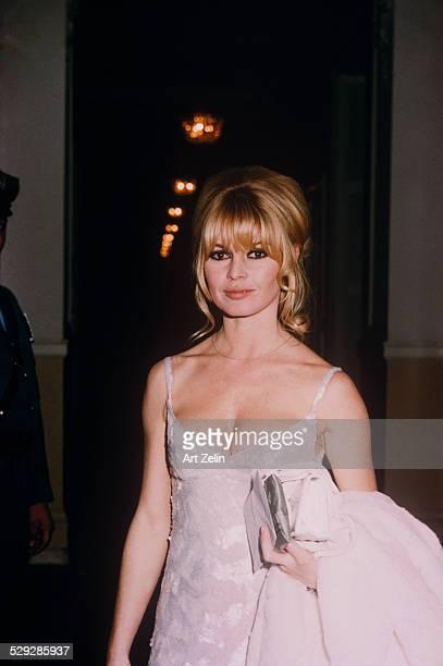 Brigitte Bardot wearing a white evening dress at the Plaza Hotel circa 1970 New York