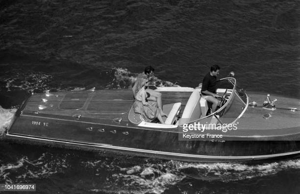 Brigitte Bardot with boyfried actor Sami Frey aboard speedboat during the shooting of movie 'Le Mépris' directed by JeanLuc Godard on May 26 1963 in...