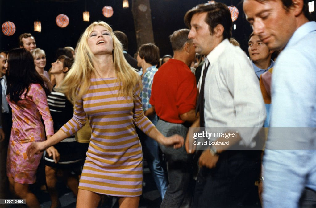Brigitte Bardot with Jean Rochefort on the set of 'A Coeur Joie' directed by Serge Bourguignon On November 24, 1966