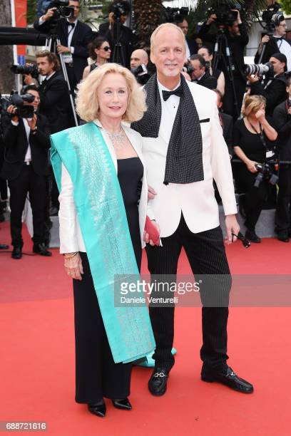Brigitte Fossey and Larry Cech attend Amant Double Red Carpet Arrivals during the 70th annual Cannes Film Festival at Palais des Festivals on May 26...