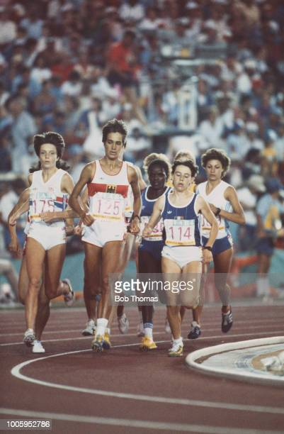 Brigitte Kraus of West Germany leads Wendy Sly of the Great Britain team and Annette Sergent of France in heat 2 of the Women's 3000 metres event...