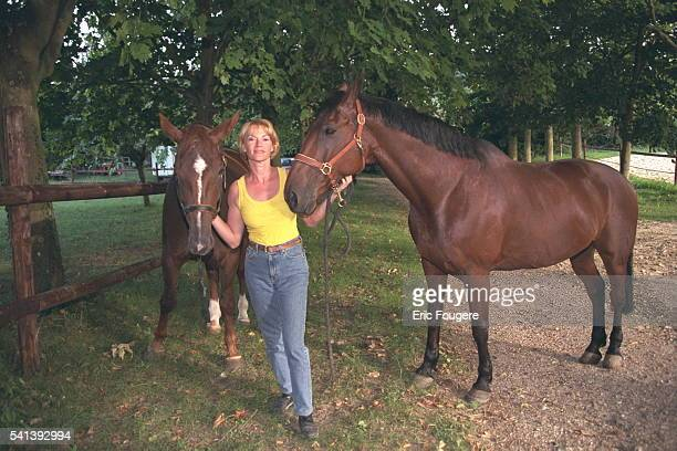 Brigitte Lahaie at home surrounded by her horses