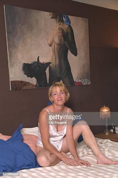 Brigitte Lahaie scantily dressed