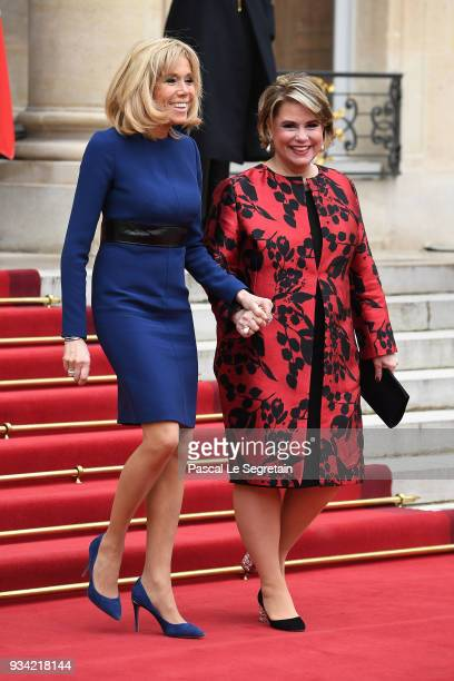 Brigitte Macron and Maria Teresa Grand Duchess of Luxembourg smile as they walk in the courtyard of Elysee Palace on March 19 2018 in Paris France...