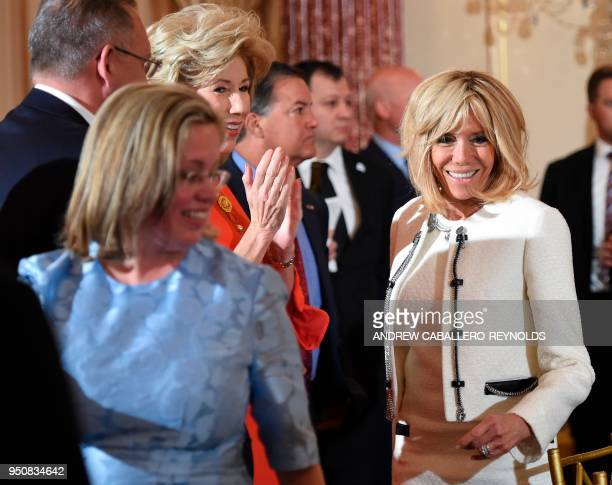 Brigitte Macron arrives for a luncheon with her husband French President Emmanuel Macron and US Vice President Mike Pence at the US State Department...