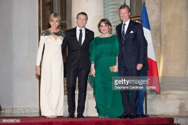 Brigitte Macron French President Emmanuel Macron GrandDuchess Maria Teresa of Luxembourg and GrandDuke Henri of Luxembourg attend a State dinner at...