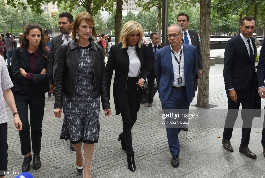 Brigitte Macron, French President's wife, (C) along with Clifford Chanin, Executive Vice President and Deputy Director for Museum Programs at The National September 11 Memorial Museum walk as she visits the 9/11 Memorial September 18, 2017, during a visit to New York along with French President Emmanuel Macron for the United Nations General Assembly. /