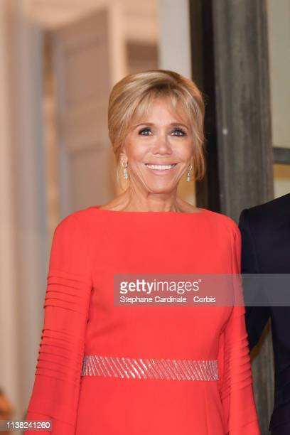 Brigitte Macron pose prior to a state dinner with Chinese President Xi Jinping at the Elysee Presidential Palace on March 25 2019 in Paris France Xi...