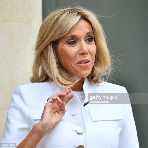 Brigitte Macron the wife of French President Emmanuel Macron greets Barbadian singer and Global Ambassador for the Global Partnership for Education...