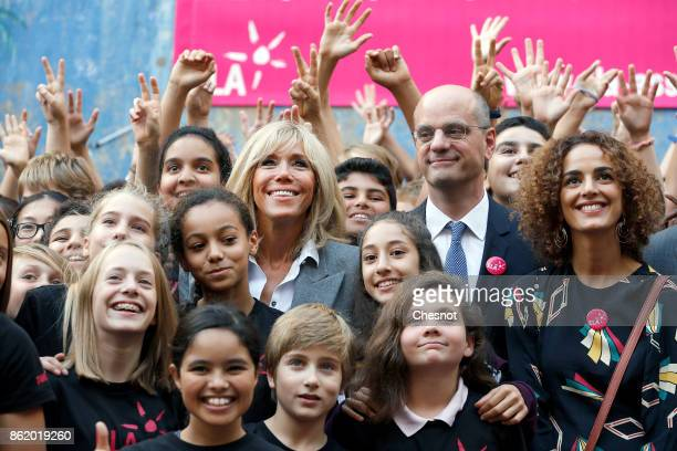 Brigitte Macron the wife of the French president French Education Minister JeanMichel Blanquer and FrenchMoroccan writer Leila Slimani pose with...