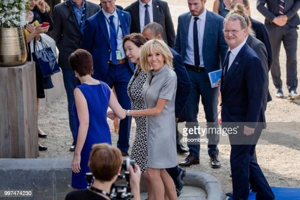 Brigitte Macron wife of Frances President Emmanuel Macron center Ingrid Schulerud wife of North Atlantic Treaty Organization secretary general Jens...
