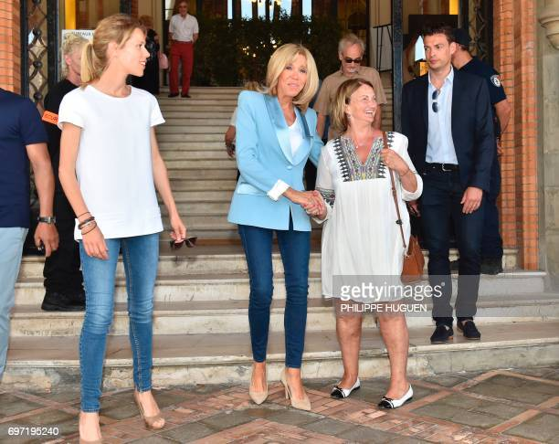Brigitte Macron wife of French President Emmanuel Macron and her daughter Tiphaine Auziere leave a polling station after voting for the second round...
