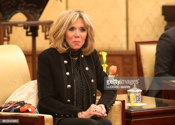 Brigitte Macron wife of French President Emmanuel Macron listens to speeches during Macron's meeting with Chinese President Xi Jinping at the...
