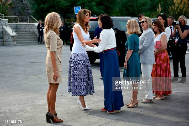 Brigitte Macron wife of French President Emmanuel Macron US First Lady Melania Trump Akie Abe wife of Japan's Prime Minister Shinzo Abe Chile's First...