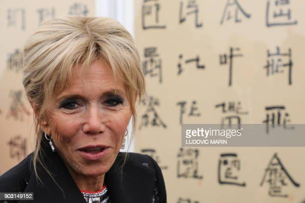 Brigitte Macron wife of French President Emmanuel Macron visits the Ullens Chinese Contemporary Art Centre in Beijing on January 9 2018 Macron is on...