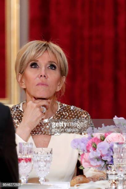 Brigitte Macron wife of the French President attends a state dinner for the Grand Duke and the Grand Duchess of Luxembourg at he Elysee Palace in...