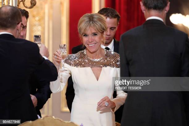 Brigitte Macron wife of the French President toasts during a state dinner for the Grand Duke and the Grand Duchess of Luxembourg at he Elysee Palace...