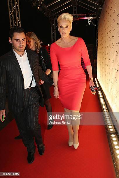 Brigitte Nielsen and her husband Mattia Dessi leave the Jaguar FType short film 'The Key' Premiere at eWerk on April 13 2013 in Berlin Germany