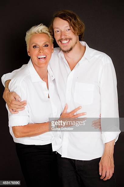 Brigitte Nielsen and her son Julian Winding pose during a portrait session on July 6 2014 in Milan Italy