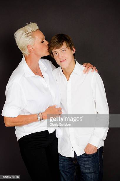 Brigitte Nielsen and her son Raoul Ayrton Meyer Jr pose during a portrait session on July 6 2014 in Milan Italy