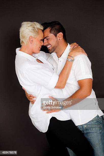Brigitte Nielsen and husband Mattia Dessi pose during a portrait session on July 6 2014 in Milan Italy