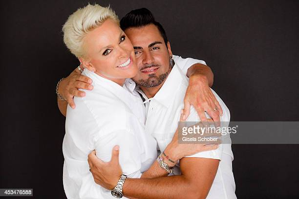 Brigitte Nielsen and husband Mattia Dessi pose during a Portrait Session on July 6 2014 in MilanoItaly
