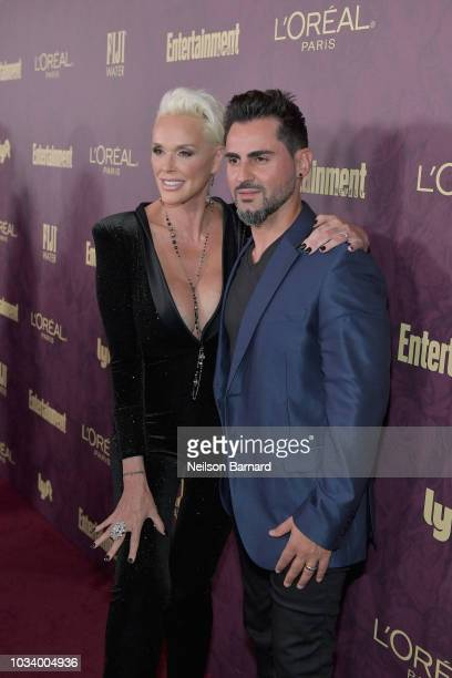 Brigitte Nielsen and Mattia Dessi attend the 2018 PreEmmy Party hosted by Entertainment Weekly and L'Oreal Paris at Sunset Tower on September 15 2018...