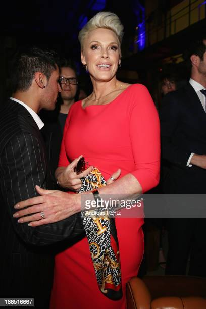 Brigitte Nielsen chats with her husband Mattia Dessi during the Jaguar FType short film 'The Key' Premiere at eWerk on April 13 2013 in Berlin Germany