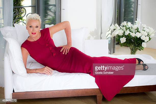 Brigitte Nielsen poses in a dress of Basler during a Portrait Session on July 6 2014 in MilanoItaly
