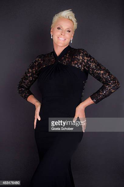 Brigitte Nielsen wearing a dress of Basler and poses during a Portrait Session on July 6 2014 in MilanoItaly