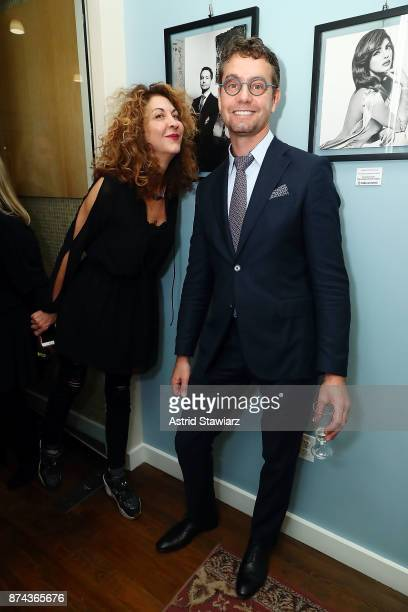 Brigitte Segura and Dr Konstantin Vasyukevich attend 'VITAL PORTRAITS' solo photography exhibition opening at Konstantin Gallery on November 14 2017...