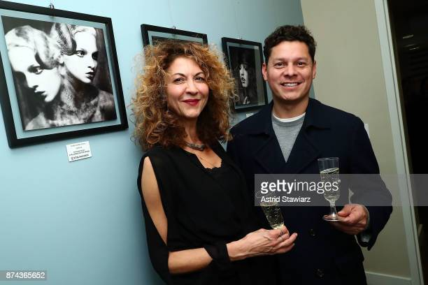 Brigitte Segura and Omar Martinez attend 'VITAL PORTRAITS' solo photography exhibition opening at Konstantin Gallery on November 14 2017 in New York...