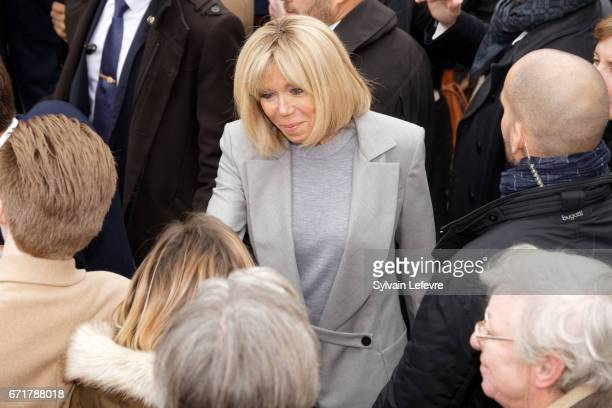 Brigitte Trogneux wife of the French presidential candidate Emmanuel Macron for the En Marche movement speaks with supporters as she leaves the...