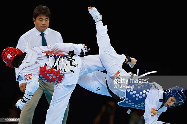Brigitte Yague Enrique of Spain competes with Chanatip Sonkham of Thailand in the womens 49kg semifinal Taekwondo match on Day 12 of the London 2012...
