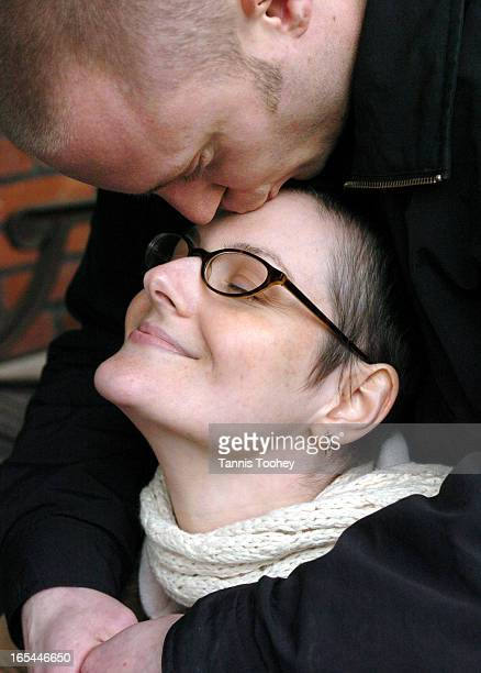 April 21 2004@*@*@*PLEASE USE THIS PHOTO NOT THE OTHER ONE@*@*@*Breast cancer survivor Brigitte Davlut with her husband Rob Duncan who shaved his...
