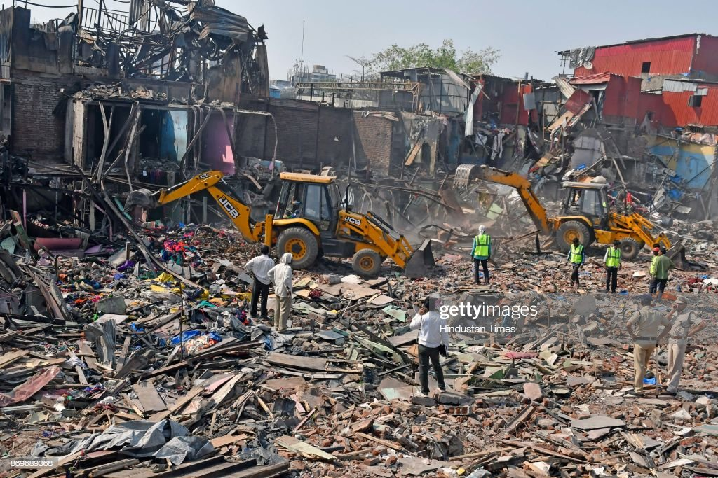 bmc resumes demolition drive at garib nagar photos and images