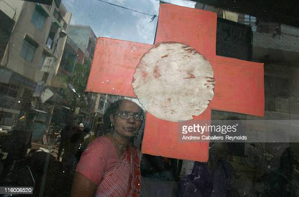 Brihat Sharma a counselor for an operation ASHA tuberculosis treatment center looks out of a window as she waits for patients on June 2 in New Delhi...