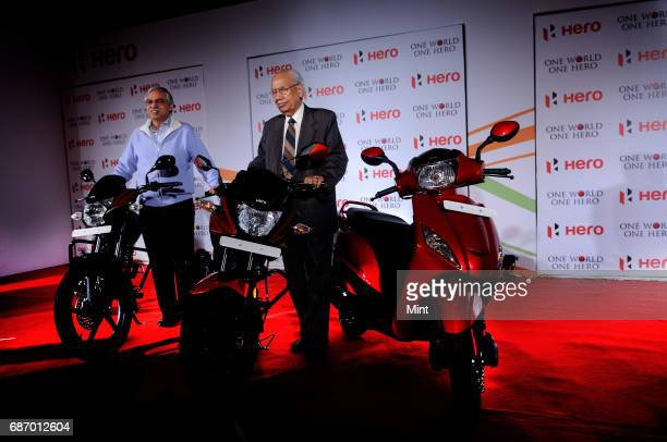 Brijmohan Lall Munjal Founder and Executive Chairman of Hero MotoCorp Ltd with Sunil Munjal Joint Managing Director of Hero MotoCorp at the launch of...