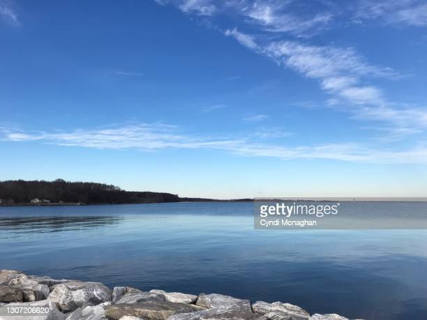 brilliant blue sky reflections on the chesapeake bay, north point state park - maryland us state stock pictures, royalty-free photos & images