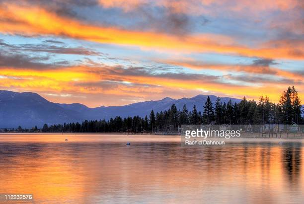 a brilliant fall sunrise is reflected in lake tahoe, california. - hilton head stock pictures, royalty-free photos & images