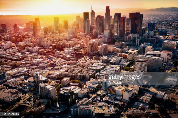 brilliant sunset beyond the los angeles skyline - city of los angeles stock pictures, royalty-free photos & images