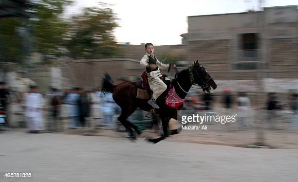 Brilliant young Hazara horseback rider galloping on crowded road. Impressed all people around him. A real Ganges Khan descendant.