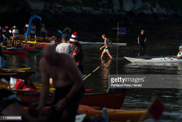 Brim Peabody of Scarborough, walks back up onto the beach on Peaks Island before the start of the annual Peaks to Portland swim race on Saturday,...