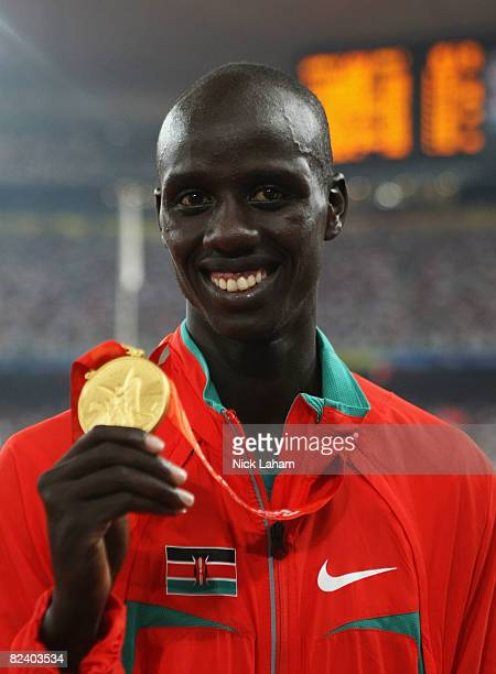 Brimin Kipruto of Kenya receives the gold medal during the medal ceremony for the Men's 3000m Steeplechase Final at the National Stadium on Day 10 of...