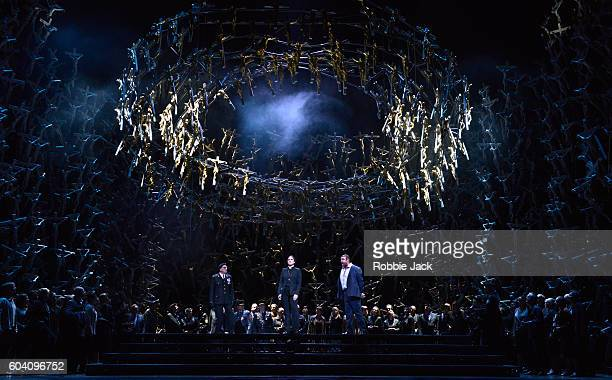 Brindley Sherratt as Oroveso Sonya Yoncheva as Norma and Joseph Calleja as Pollione with artists of the company in the Royal Opera's production of...