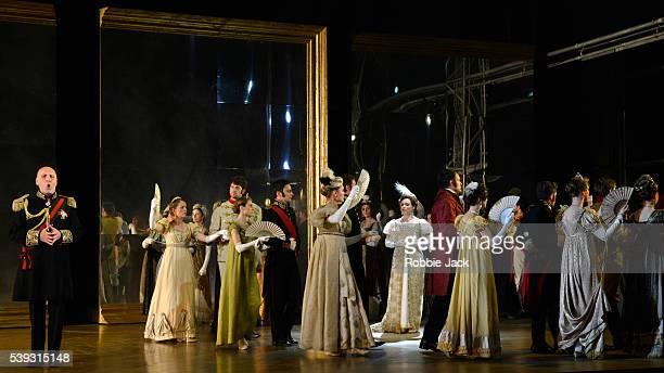 Brindley Sherratt as Prince Gremin and Natalya Romaniw as Tatyana with artists of the company in Garsington Opera's production of Pyotr Ilyich...