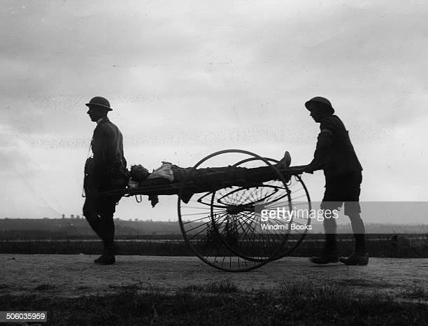 Bringing back a wounded man from the trenches on a wheeled stretcher La BoiselleAmiens Road July1916 British Front France General Battle Somme