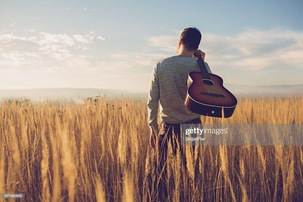 Bringing My Guitar Wherever I Go : Stock Photo